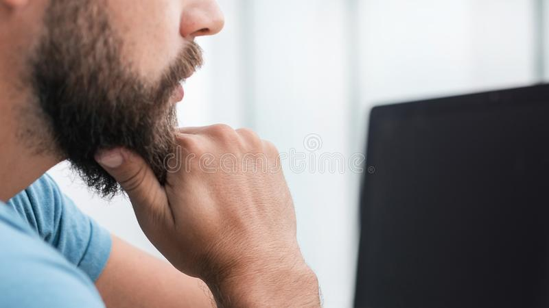 Close up. serious man pointing at computer screen . stock image
