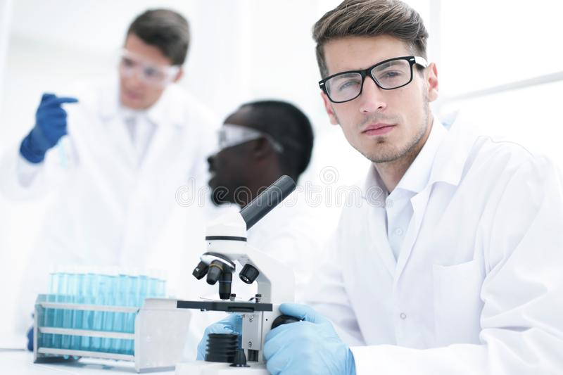 Close up.serious scientist scientist sitting at the table royalty free stock image