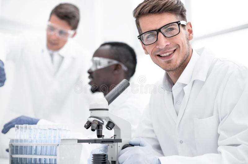 Close up.serious scientist scientist sitting at the table stock images