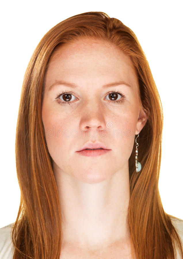 Close Up of Serious Woman. Single isolated serious female with blank stare royalty free stock image