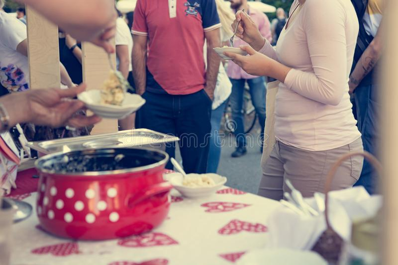 Close up of serving delicious pasta at outdoor event. royalty free stock images