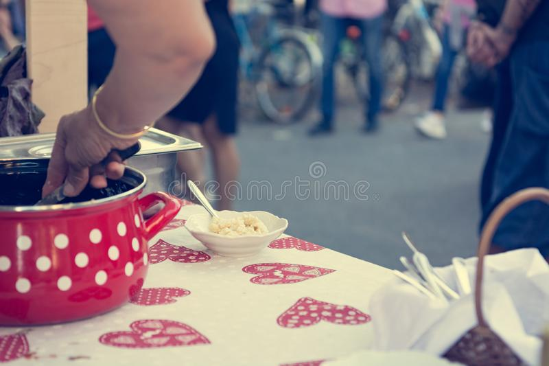 Close up of serving delicious pasta at outdoor event. stock image
