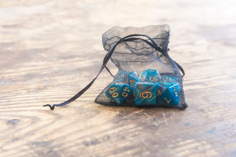 Close up set of blue color dice for many role playing games on wooden table royalty free stock image