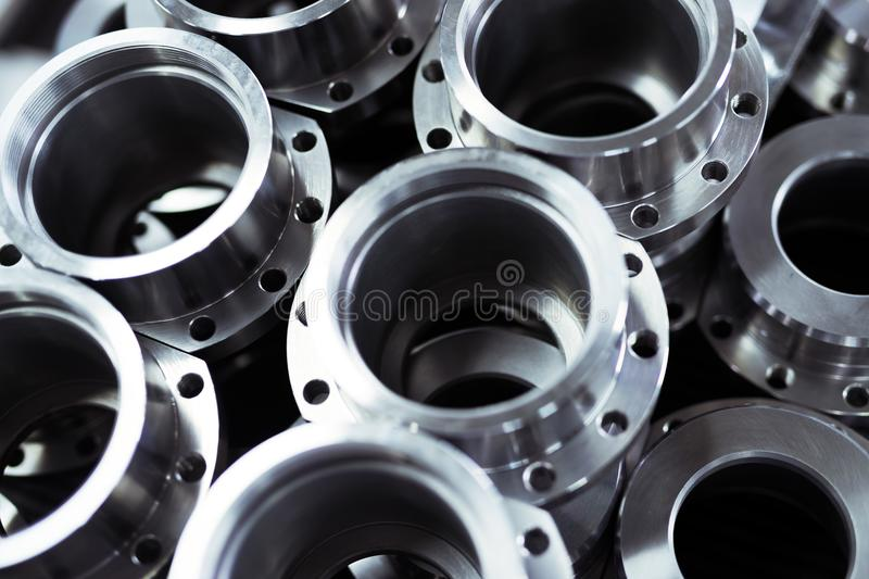 Close-up of a set of metallic gears and parts. Produced in metal factory stock photos