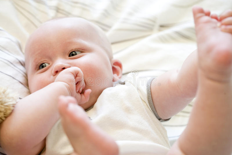 Close Up Of Seven Month Old Baby Lying On Back Stock Image