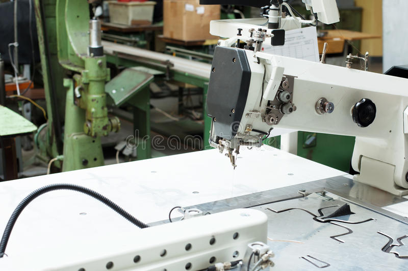 Close-up of sewing machine and patterns for shoes. Image of sewing machine and patterns for shoes, close-up stock image