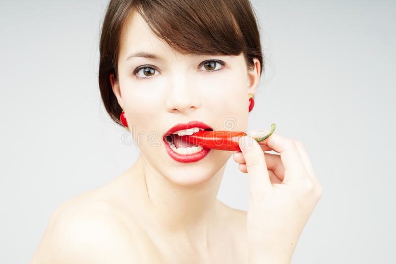 Download Close Up Of A Woman Biting A Chili Pepper Stock Photo - Image: 14850928