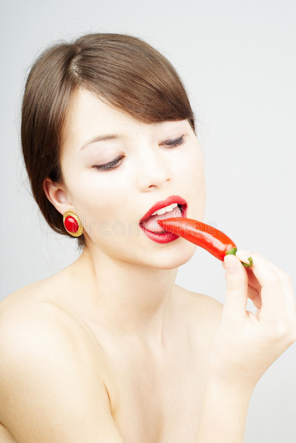 Download Close Up Of A Woman Biting A Chili Pepper Stock Photo - Image: 14850978