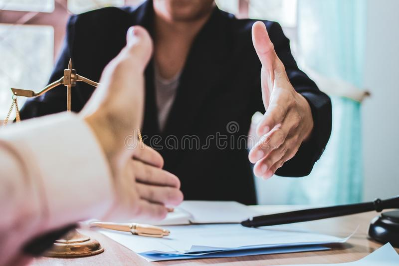 Close-up Shake hands lawyers in office. Counseling and Give an advice between private and government officials to find a fair stock images