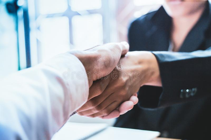 Close-up Shake hands lawyers in office. Counseling and Give an advice between private and government officials to find a fair royalty free stock photography