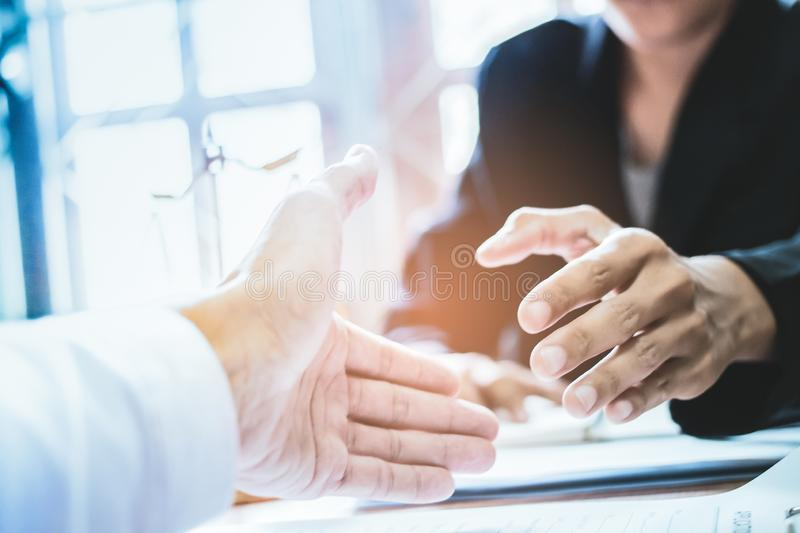 Close-up Shake hands lawyers in office. Counseling and Give an advice between private and government officials to find a fair stock photo