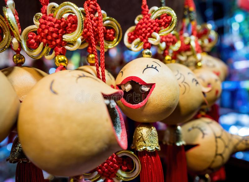 Close-up, shallow depth-of-field view of some hanging souvenir trinkets from a street stall royalty free stock photo