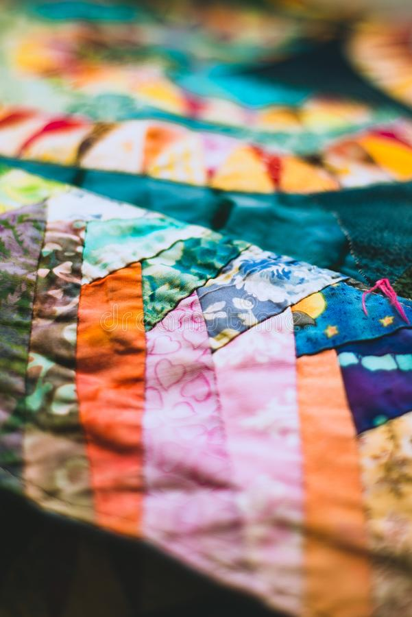Close Up Shallow Focus Detail from a Handmade Vintage Patchwork Quilt stock photography