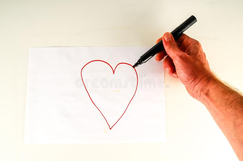 Close-up of sheet with drawing heart. Object on a White Background stock photos