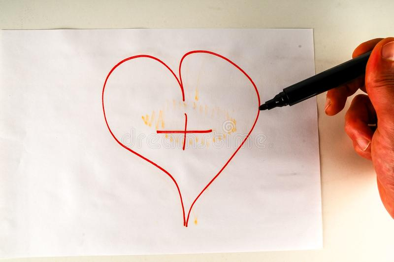 Close-up of sheet with drawing heart. Object on a White Background stock image