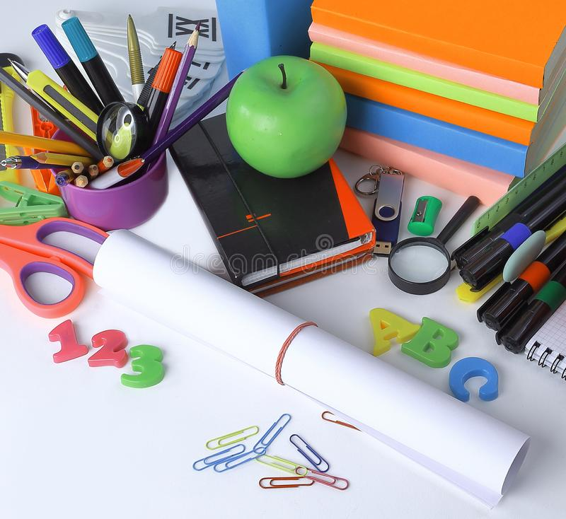 Close up.a sheet of drawing paper and school supplies isolated on white background.  stock image
