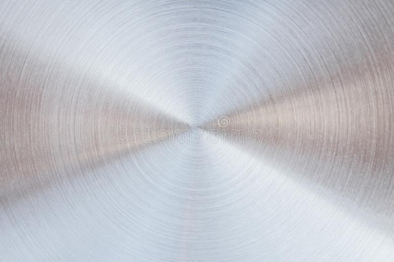 Shiny metal circle in many layer overlap patterns abstract royalty free stock photo