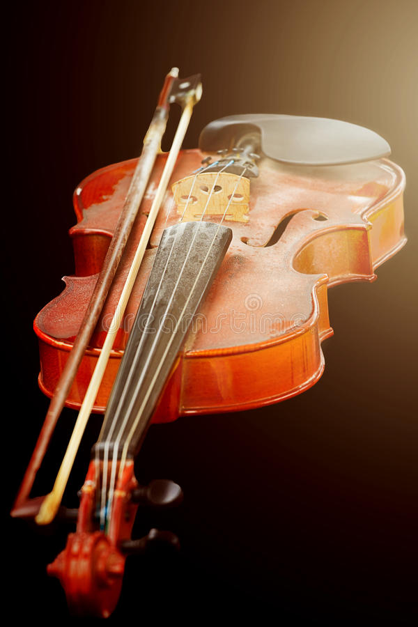 Close up of shiny violin on wooden table,. Isolated on black background, with clipping path royalty free stock photos