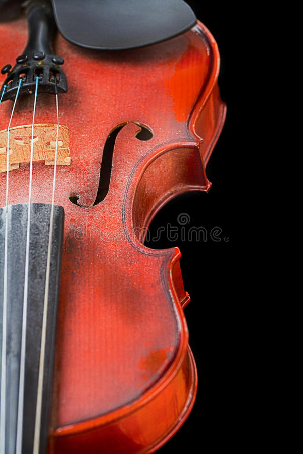Close up of shiny violin on wooden table,. Isolated on black background, with clipping path royalty free stock photography