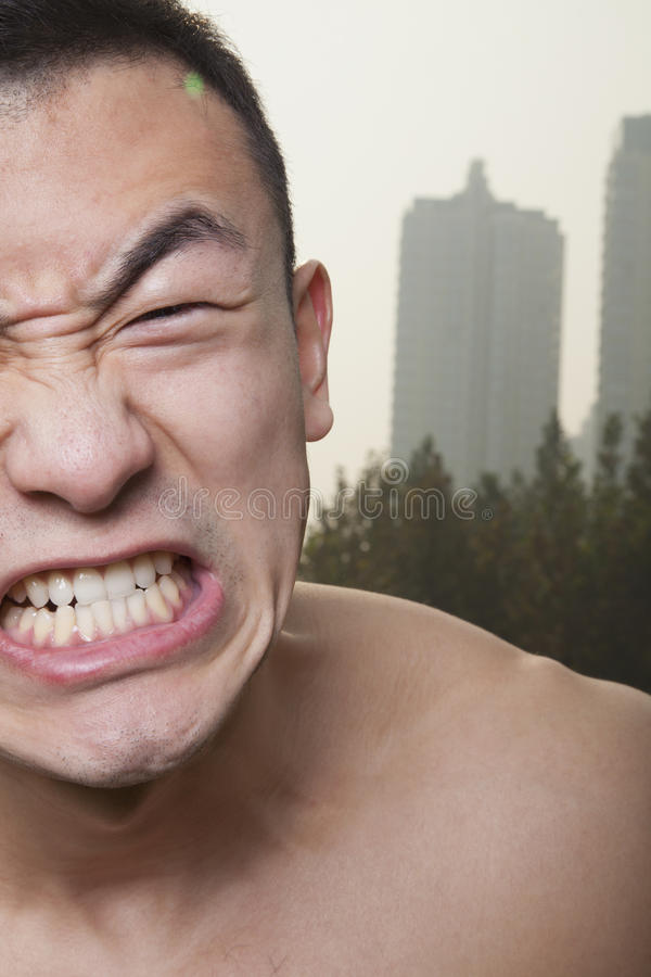 Close up of shirtless young athletic man growling stock images