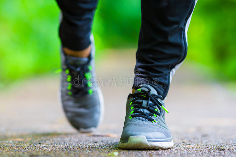 Close-up on shoe of athlete runner man feet. Closeup on shoe of athlete runner man feet running on road royalty free stock images