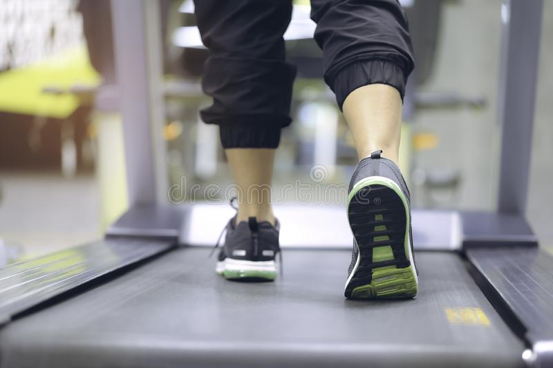 Close up on shoe, Woman training with legs running on treadmill. And burn fat in the body in the gym, Healthy lifestyle and sport concep stock photos