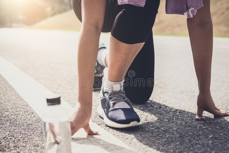 Close up on shoes, athlete runner feet running on track to begin. Starting stock photo