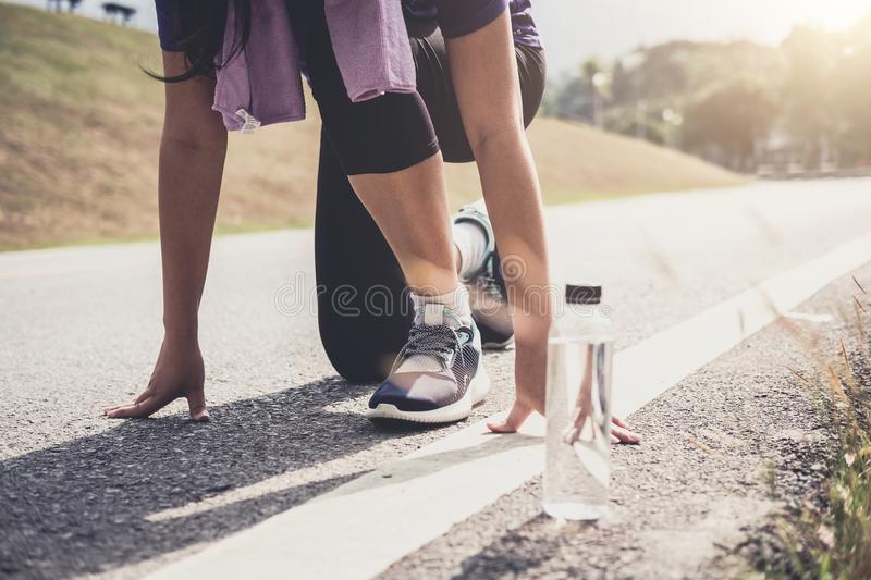 Close up on shoes, athlete runner feet running on track to begin. Starting stock photography