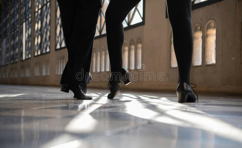 Close up of  the shoes of dancers dancing in the hall. Close up of the shoes of ballroom dancers dancing in the hall royalty free stock photo