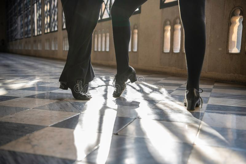 Close up of  the shoes of dancers dancing in the hall. Close up of the shoes of ballroom dancers dancing in the hall stock photo