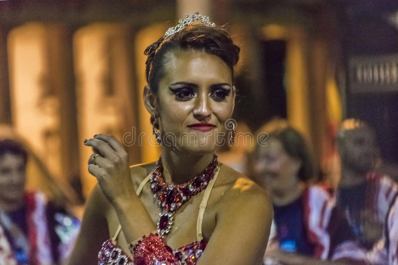 Close-Up Shoot Costumed Woman Dancer at Carnival Parade. MONTEVIDEO, URUGUAY, JANUARY - 2016 - Close-up shoot of attractive costumed young woman dancer at royalty free stock photography