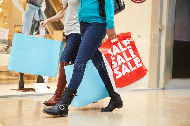 Close Up Of Shoppers Carrying Bags In Mall stock image