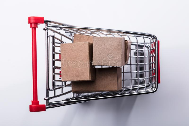 Close-up Of Shopping Cart With Cardboard Boxes stock photos
