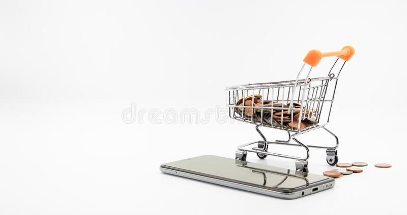 Shopping cart coin smartphone white background concept e-commerce. Close up shopping cart coin smartphone white background concept e-commerce And the digital stock image