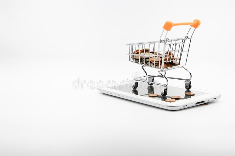 Close up Shopping cart on smartphone White background E-commerce. Close up shopping cart Coin on smartphone White background E-commerce concept And the digital royalty free stock photo