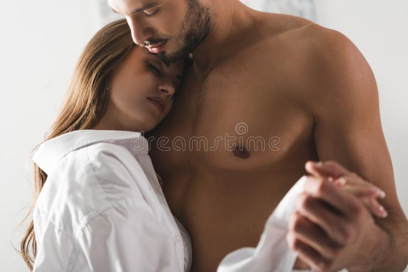 close-up shot of attractive young couple dancing at home stock photography