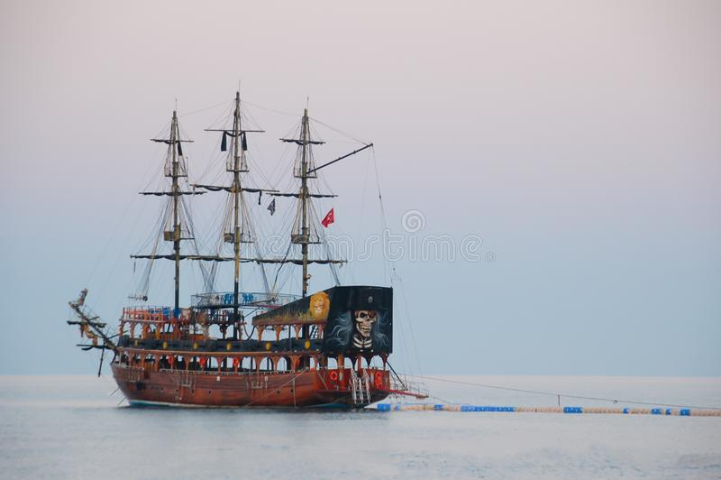Pirate ship, sailing type, moored at the pontoon pier early in the morning. stock photo