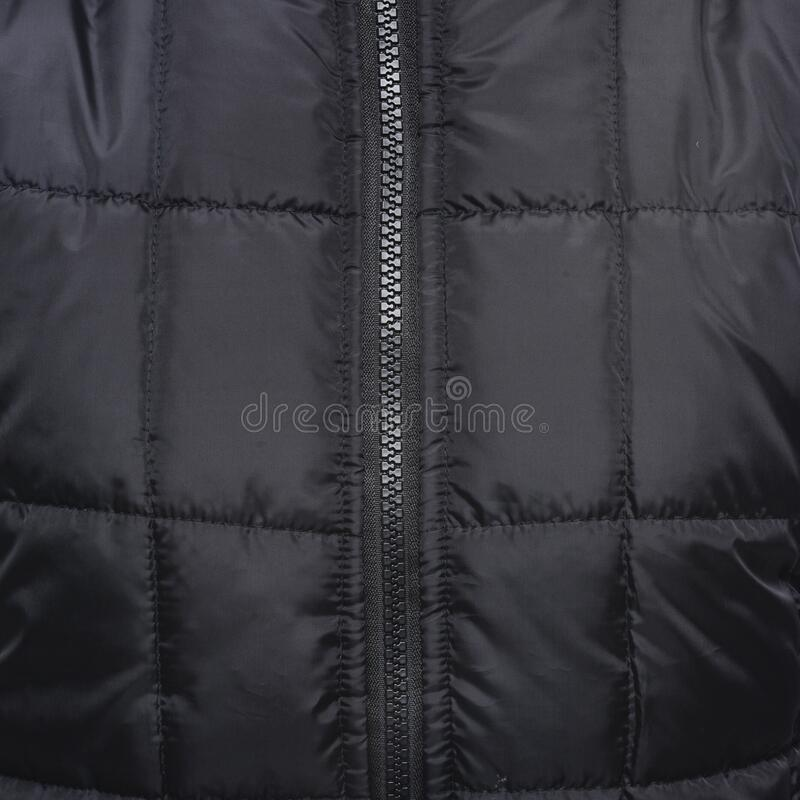 Close Up Shot of Black Zip Up Quilted Textile royalty free stock photo