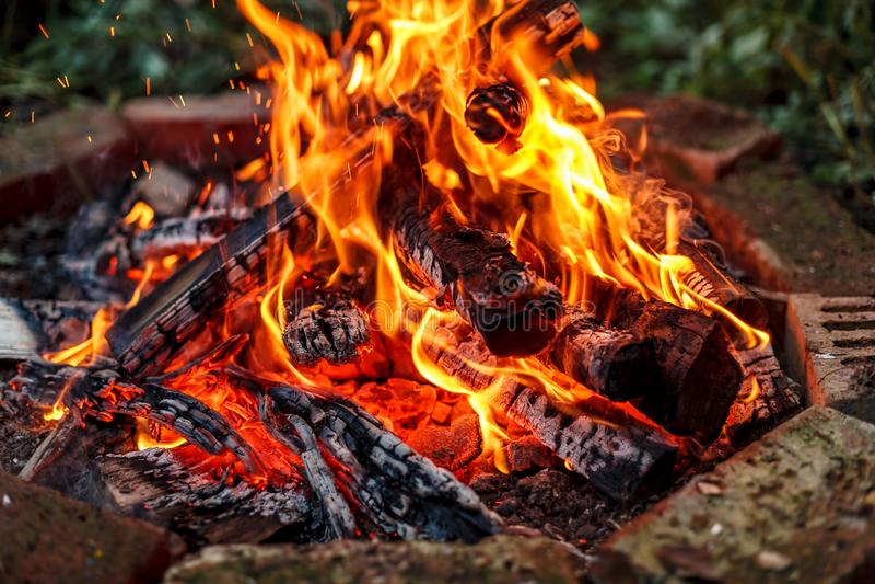 Close-up shot of bonfire in circle of red bricks royalty free stock images