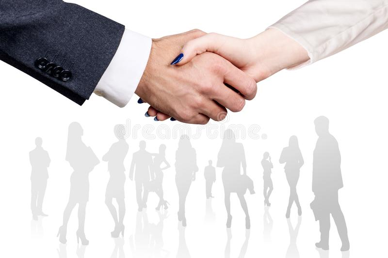Close-up shot on business handshake over business people croud background. royalty free stock image