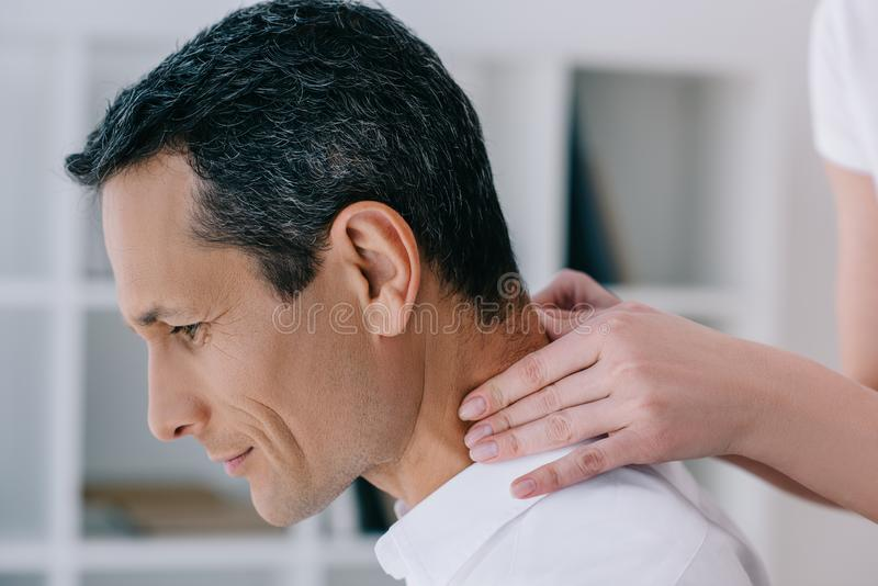 close-up shot of businessman having office massage royalty free stock photo