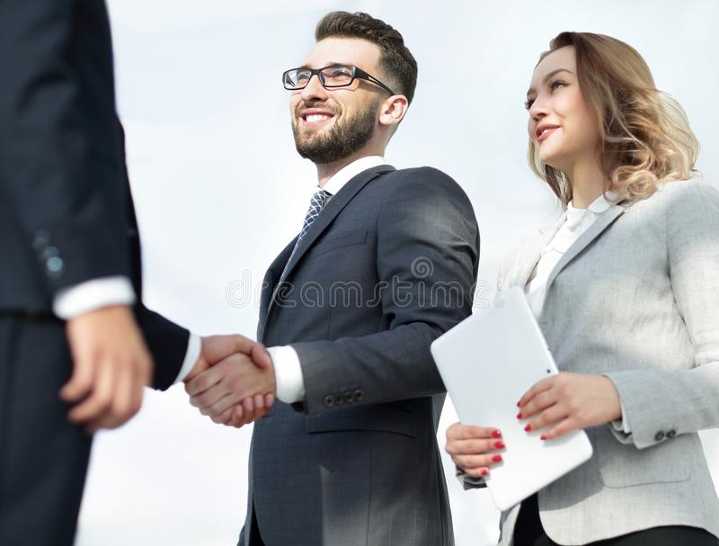 Successful business people handshake greeting deal concept. Close-up shot of businessmen shaking hands in the office royalty free stock images