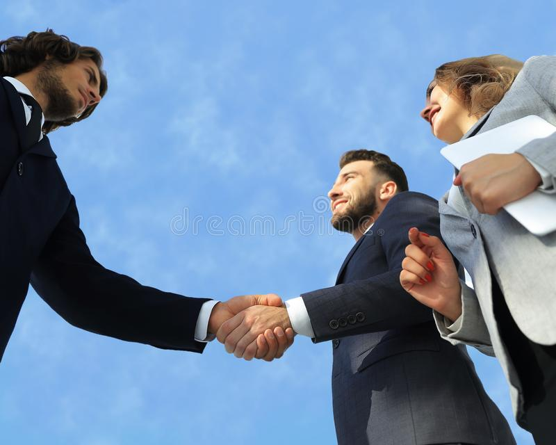 Successful business people handshake greeting deal concept. Close-up shot of businessmen shaking hands in the office stock images