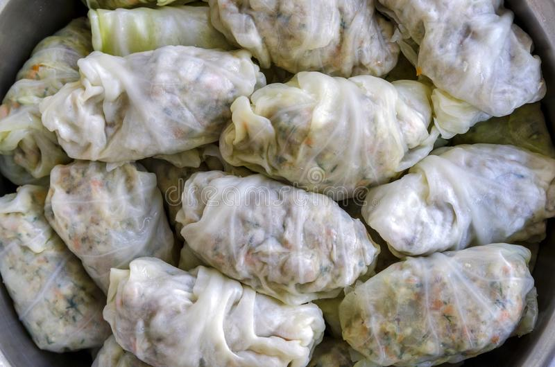 Close-up shot of Cabbage Rolls or Dolma. Stuffed cabbage leaves with minced meat, rice, vegetables and herbs stock images