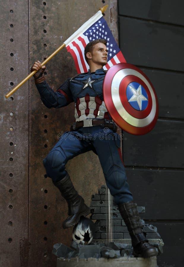 Close up shot of Captain America Civil War superheros figure in action with America Flag at dezign66 studio in bangkok Thailand stock images