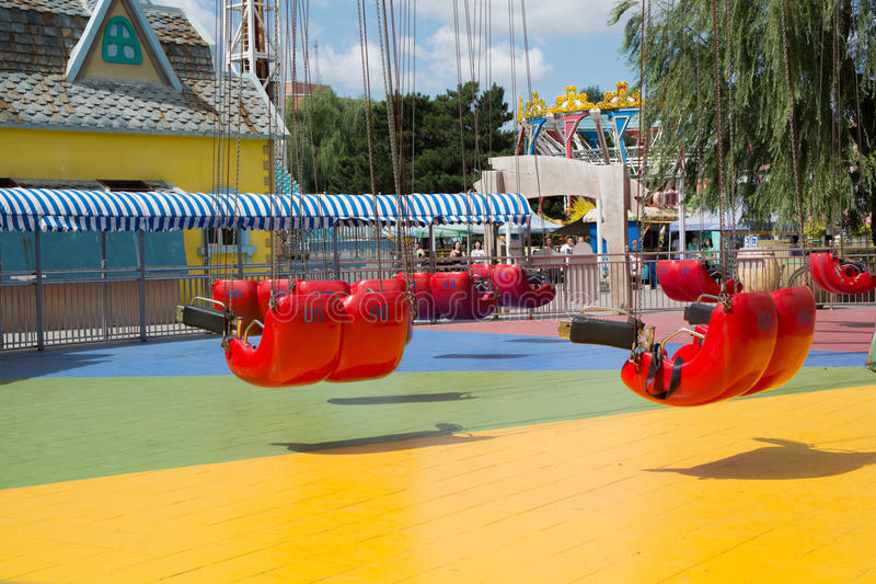 Close up shot of carnival ride swings stock image