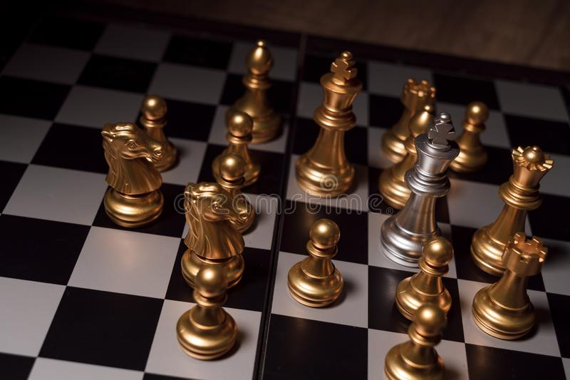 Close up shot chess on the board game with dark mood and tone process competition concept royalty free stock photos