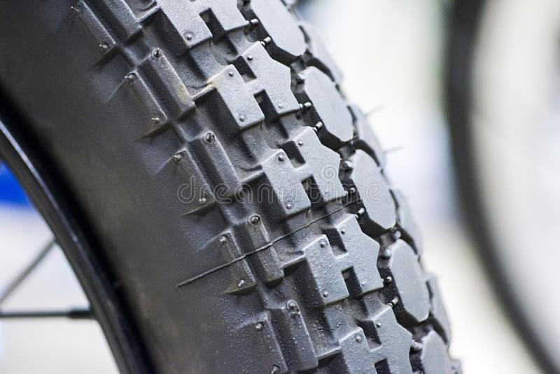 Close-up shot of classical motorcycle tire tread. Close-up protector of tire - wheel service.  royalty free stock image