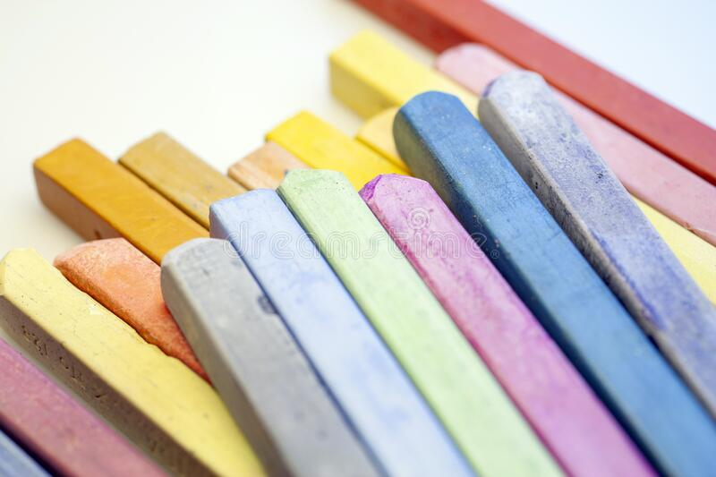 Close up shot of colorful crayons on white background.  royalty free stock photo