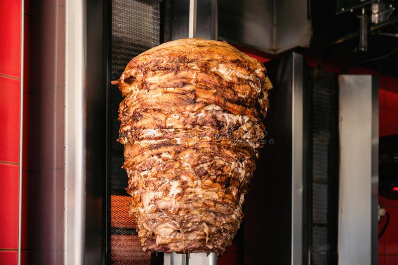 Doner Kebab On Rotating Vertical Spit. A close-up shot of delicious Doner kebab meat on a rotating vertical spit royalty free stock photo